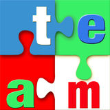 Team Puzzle. The word team in letters connected in a colorful puzzle with blue, green, white, and red.  Vivid, clean, crisp, and bright with good 3d depth Stock Photo