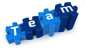 Team puzzle text. Team text on blue puzzle, isolated Stock Images