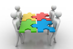 Team with the puzzles in hands Royalty Free Stock Photo