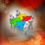 Team with the puzzles in hands Royalty Free Stock Photos