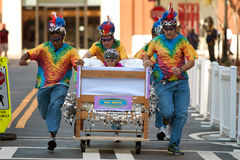 Team Races Mattress On Wheels In Fundraiser Event Royalty Free Stock Photos