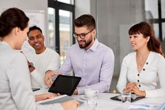 Team of recruiters with tablet pc at job interview stock photos
