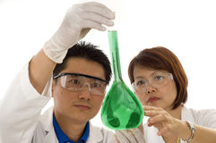 Team of Researchers holding flask with chemicals Royalty Free Stock Image