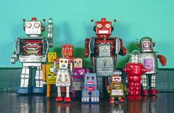 A team of retro robots on a wooden floor. A  big team of retro robots on a wooden floor Royalty Free Stock Photography