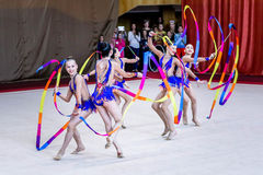 Team Rhythmic Gymnastics acts with ribbons Royalty Free Stock Photography