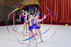 Team Rhythmic Gymnastics acts with ribbons Stock Photo