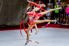 Team Rhythmic Gymnastics acts with ribbons. Chelyabinsk, Russia, on May 17, 2015: Team Tyumen region performs the routing ribbons during Championship of the Ural stock images
