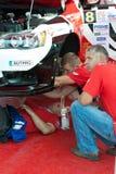 Team riders prepares car to Prime Yalta Rally. YALTA, UKRAINE - SEPTEMBER 13, 2012: team riders PUSHKAR Vitaliy and MISHYN Ivan from Ukraine prepares Mitsubishi Stock Photography