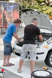 Team riders prepares car to Prime Yalta Rally. YALTA, UKRAINE - SEPTEMBER 13, 2012: team riders IATSIUK Olexiy and AKSONOV Denys from Ukraine prepares Skoda Royalty Free Stock Photo