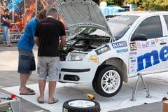 Team riders prepares car to Prime Yalta Rally. YALTA, UKRAINE - SEPTEMBER 13, 2012: team riders IATSIUK Olexiy and AKSONOV Denys from Ukraine prepares Skoda Stock Photos