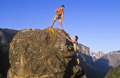 Team of rock climbers. Stock Photo