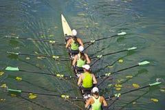 Team of rowing Four-oar women Stock Photos