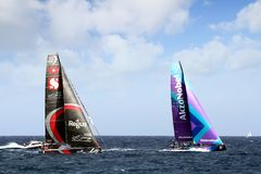Team Scallywag and Akzonobel in race after leave the port of Alicante. Team Scallywag and Akzonobel moments after start Leg 1 Alicante-Lisbon of the Volvo Ocean Stock Photo