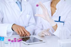 Team of  scientific researchers in laboratory studying substances or blood sample. New vaccine for pharmacology industr. Y is s almost ready. Medicine and Royalty Free Stock Image