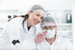 Team of scientists in a laboratory working on Stock Photography
