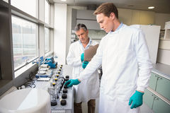 Team of scientists working together stock photography