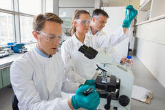 Team of scientists working together Stock Images