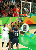Team Serbia in action during group A basketball match of the Rio 2016 Olympic Games against team France Stock Photos