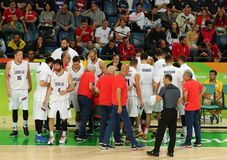 Team Serbia in action during group A basketball match of the Rio 2016 Olympic Games against team France Royalty Free Stock Image