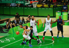 Team Serbia in white and team France in action during group A basketball match of the Rio 2016 Olympic Games Stock Image