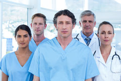 Team of serious doctors looking at camera Stock Photos