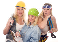 Team sexy women contractors tools. Group of sexy contractors or builders or homemaker females with tools and boss writing an estimate contract Stock Photos