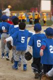 Team shake. Two youth baseball teams line up after game Stock Photo
