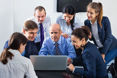 Team sharing ideas on project during coffee break Royalty Free Stock Image
