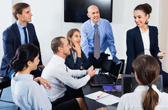 Team sharing ideas on project during coffee break Royalty Free Stock Photo