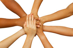 Team showing unity, people putting their hands together Stock Photos