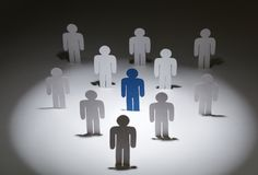 Team of similar papermen with a blue one Royalty Free Stock Photo