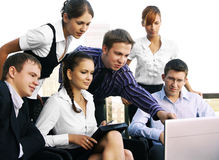 A team of six business persons is working together Royalty Free Stock Images