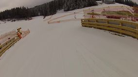 Team of skiers coming down the ski run in Bukovel stock footage
