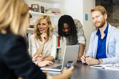 Team of skilled designers and business people Stock Photography