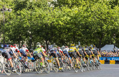 Team Sky in Paris - Tour de France 2016. Paris, France - July 24, 2016: Team Sky with Froome in Yellow Jersey in the peloton passing by the Arch de Triomphe on Royalty Free Stock Photos