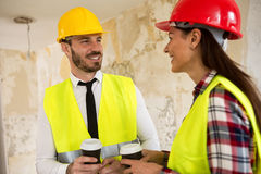 Team of smiling architects at coffee break. Construction site Royalty Free Stock Images