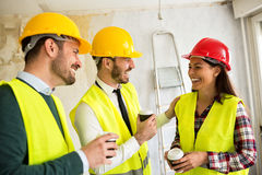 Team of smiling architects at coffee break. Construction site Royalty Free Stock Photo