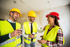 Team of smiling architects at coffee break. Construction site Royalty Free Stock Photography