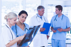 Team of smiling doctors discussing Stock Images