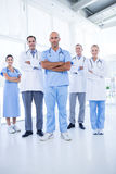 Team of smiling doctors looking at camera with arms crossed Stock Photo