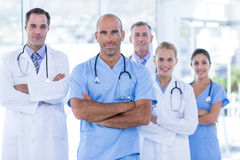 Team of smiling doctors looking at camera with arms crossed Stock Image