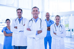 Team of smiling doctors looking at camera with arms crossed Stock Images