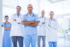 Team of smiling doctors looking at camera with arms crossed Royalty Free Stock Photography