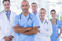Team of smiling doctors looking at camera with arms crossed Stock Photography