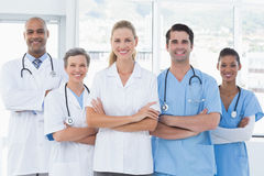 Team of smiling doctors looking at camera Stock Image