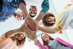 Team of smiling executives forming hand stack Royalty Free Stock Photos
