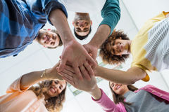 Team of smiling executives forming hand stack Royalty Free Stock Images
