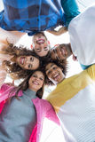 Team of smiling executives forming huddle Royalty Free Stock Photos