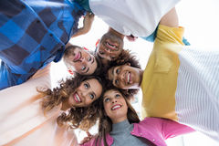 Team of smiling executives forming huddle Stock Photos