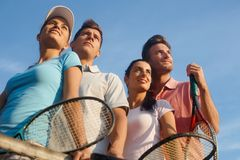 Team of smiling tennis players. Photographed from below Stock Images